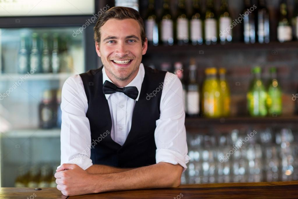 party bartender leaning on bar counter
